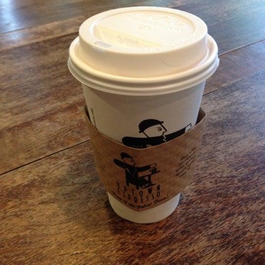 Photo taken at Uptown Espresso by erik m. on 6/22/2012