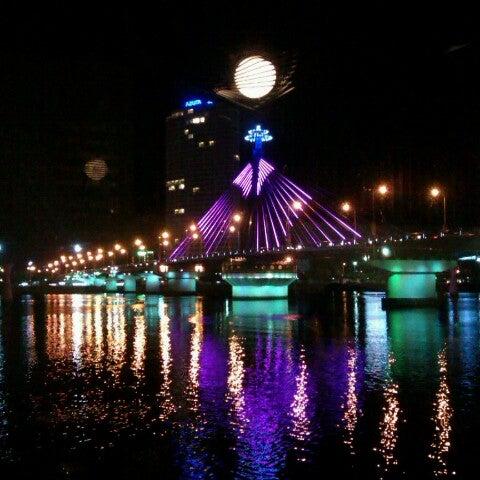 Photo taken at Han River Bridge by Thuy N. on 8/6/2012