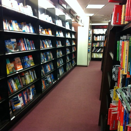 Photo taken at Harvard Coop Society Bookstore by Camila F. on 7/3/2012