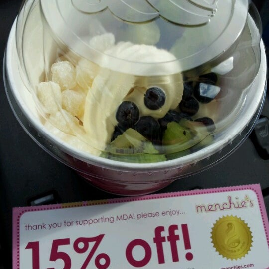 Photo taken at Menchie's Red Bug Village by Melissa G. on 8/5/2012
