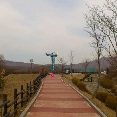 Photo taken at Yuldong Park by tazo k. on 2/26/2012