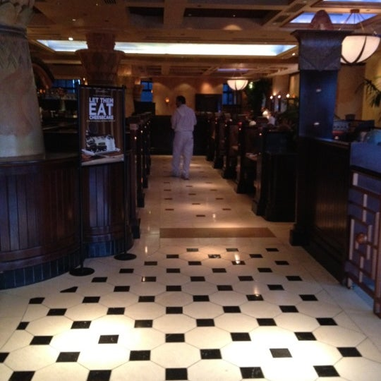 Photo taken at The Cheesecake Factory by C W. on 7/4/2012