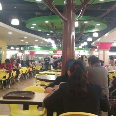 Photo taken at Oasis Food Court by Puteri E. on 8/30/2012