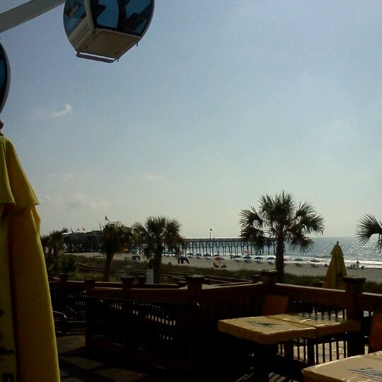 Photo taken at Landshark Bar & Grill by Gina D. on 4/29/2012