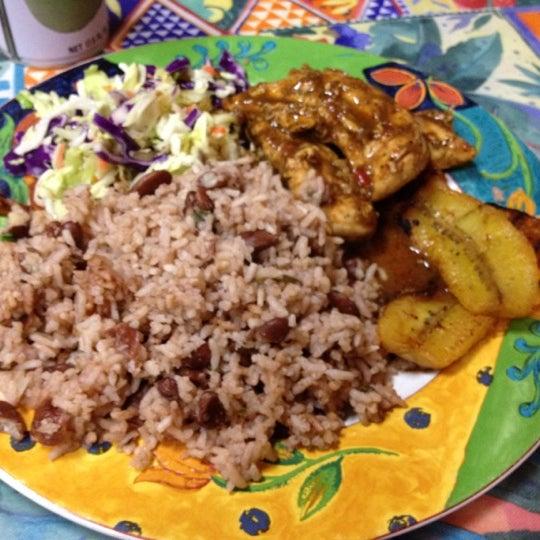 Photo taken at Mama Jamaica's Kitchen by Galina Y. on 3/25/2012