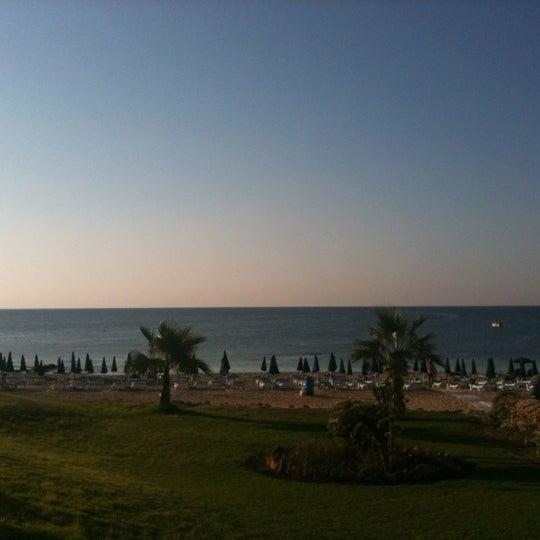 Photo taken at Makronissos Beach by Алексей К. on 8/20/2012