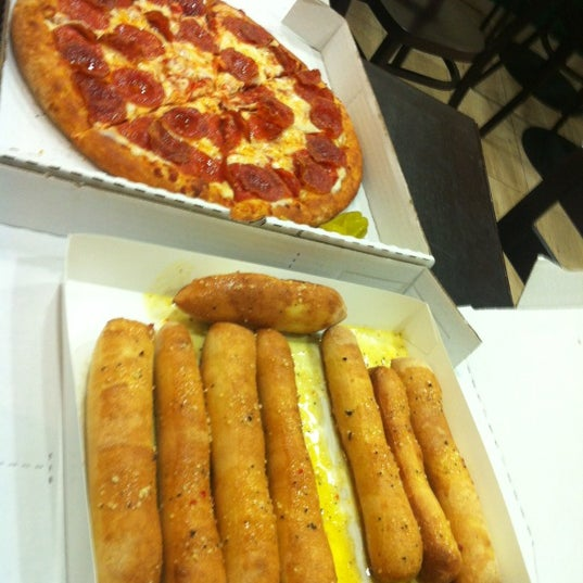 Photo taken at Papa John's by Camila I. on 4/26/2012
