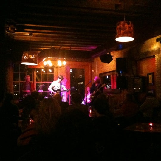 Photo taken at Aster Cafe by Karrie V. on 4/4/2012
