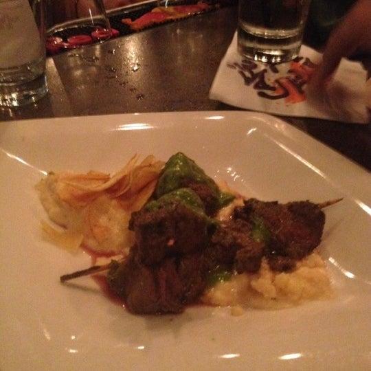 Photo taken at Café Tu Tu Tango by Pi on 9/9/2012