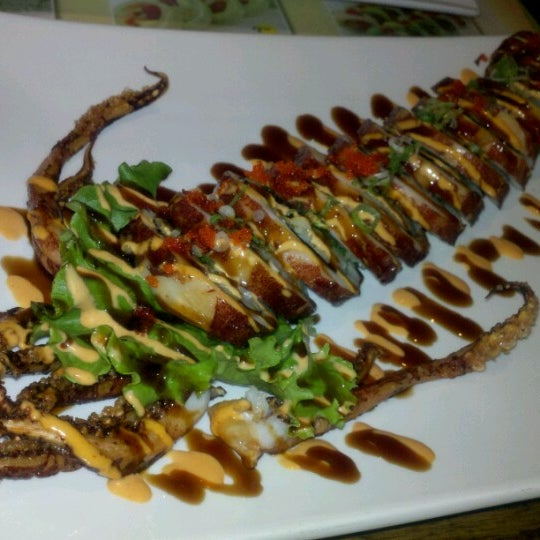 Photo taken at Tomo Japanese Cuisine by Rhea P. on 7/10/2012