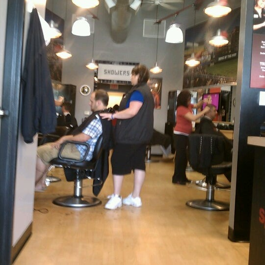 Photo taken at Sport Clips Haircuts of Mooresville by Marcus C. on 7/29/2012