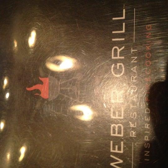 Photo taken at Weber Grill Restaurant by Joe K. on 7/13/2012