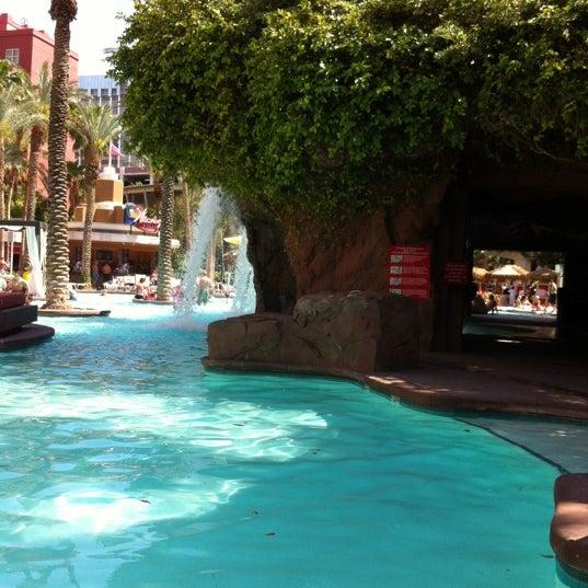Photo taken at Flamingo GO Pool by Aurora C. on 5/7/2012