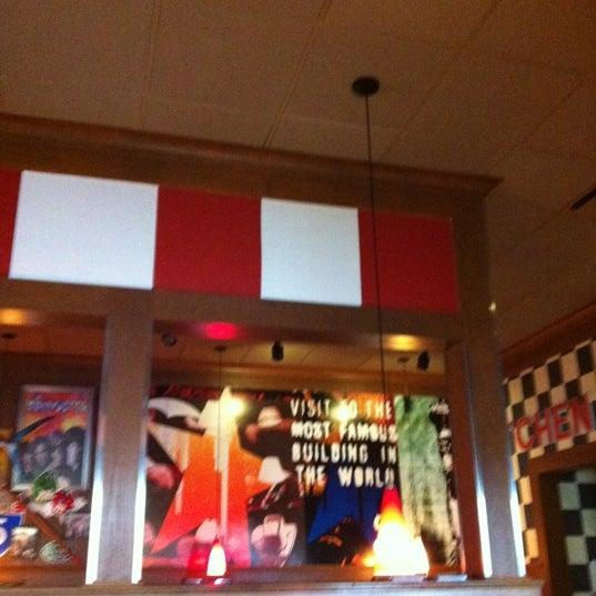 Photo taken at TGI Fridays by Jennifer B. on 7/22/2012
