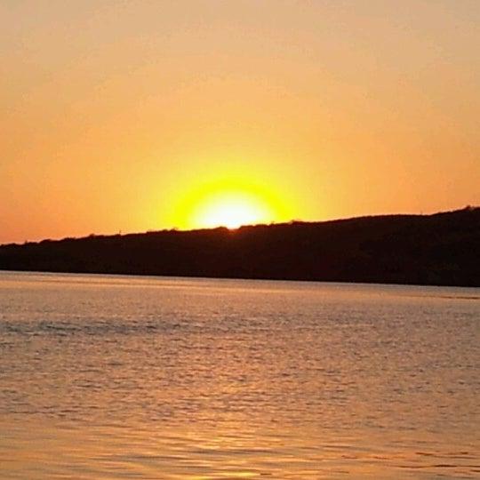 Photo taken at Playa Pichilingue by Anita H. on 8/3/2012