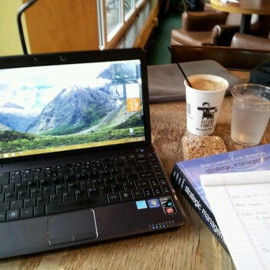 Photo taken at Uptown Espresso by Scott G. on 4/20/2012