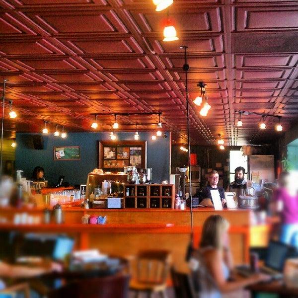 Photo taken at Bennu Coffee by Jon E. on 7/9/2012