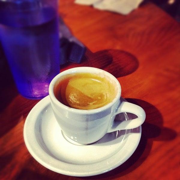 Photo taken at Bennu Coffee by Martín on 8/27/2012