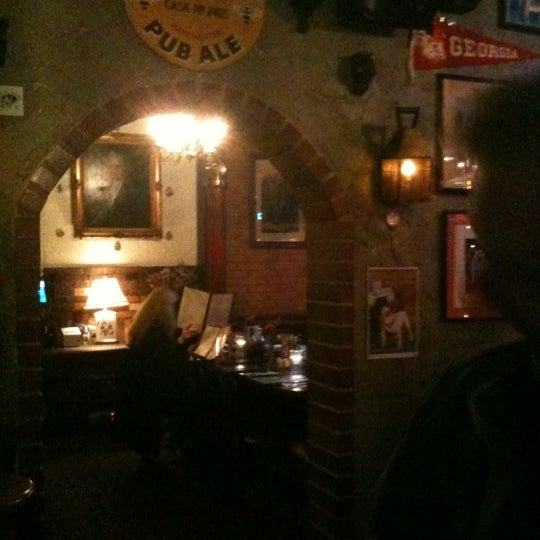 Photo taken at Ye Olde King's Head by Angie D. on 3/11/2012