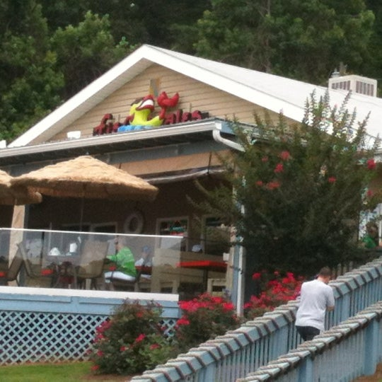 Photo taken at Fish Tales Lakeside Grille by Susan E. on 6/16/2012