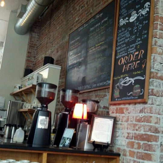 Photo taken at Victrola Cafe and Roastery by Jonathan L. on 5/26/2012