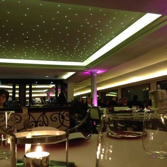 Photo taken at Imago Restaurant by Teddy L. on 4/13/2012