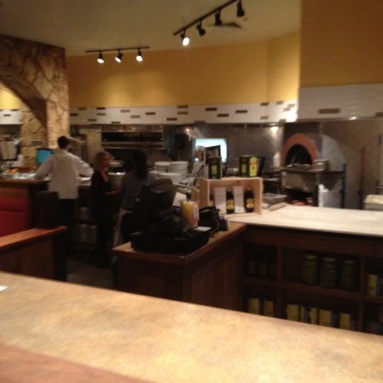 Photo taken at Romano's Macaroni Grill by Sergio L. on 4/8/2012