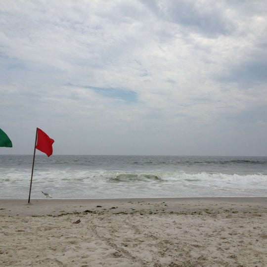 Photo taken at East Atlantic Beach by Joshua C. on 7/15/2012