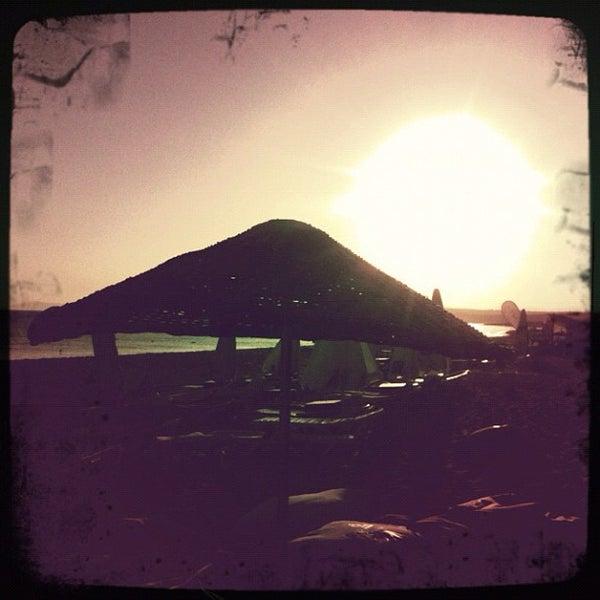 Photo taken at Ramo Beach by Ezgi on 9/12/2012