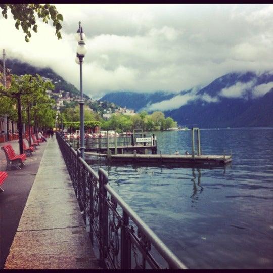 Photo taken at Lago di Lugano by Ekaterina B. on 5/6/2012
