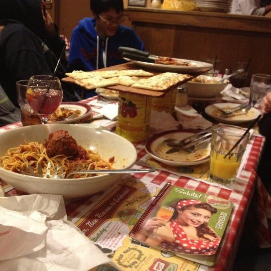 Photo taken at Buca di Beppo by Aaron S. on 2/18/2012