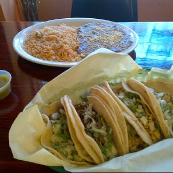 Photo taken at Leos Mexican Grill by Kristy D. on 6/5/2012
