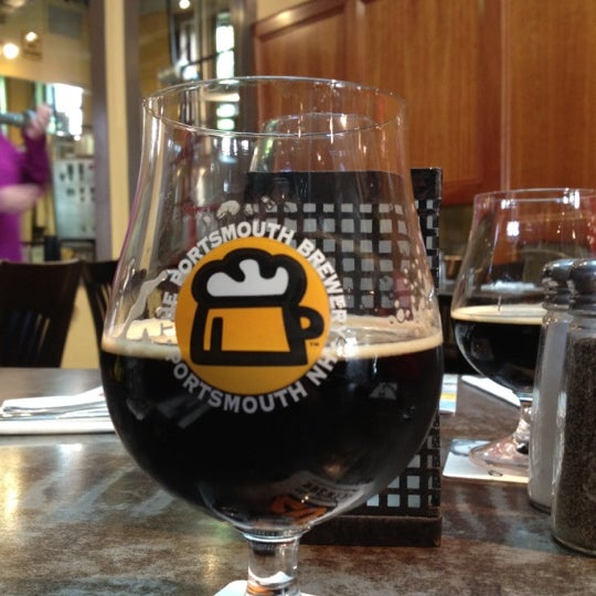 Photo taken at Portsmouth Brewery by Braxton W. on 5/17/2012