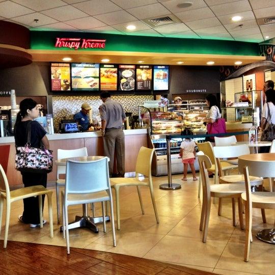 Photo taken at Krispy Kreme by Arlene on 3/13/2012