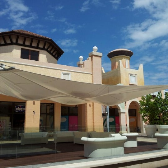 Photo taken at Fashion District - Molfetta Outlet by Vincenzo D. on 7/25/2012