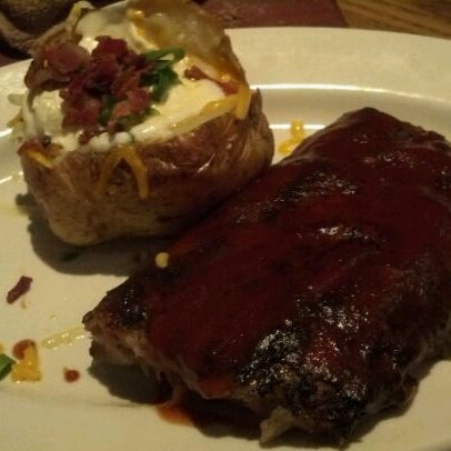 Foto tirada no(a) Outback Steakhouse por Rodrigo H. em 5/22/2012