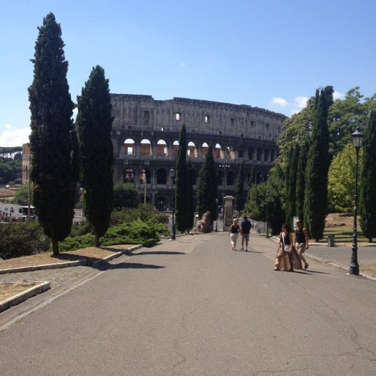Photo taken at Piazza del Colosseo by Ilia K. on 8/16/2012