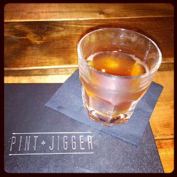 Photo taken at Pint + Jigger by Kim Y. on 7/18/2012