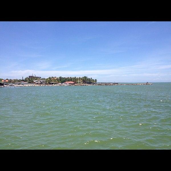 Photo taken at Playa El Yaque by Efrain G. on 8/25/2012