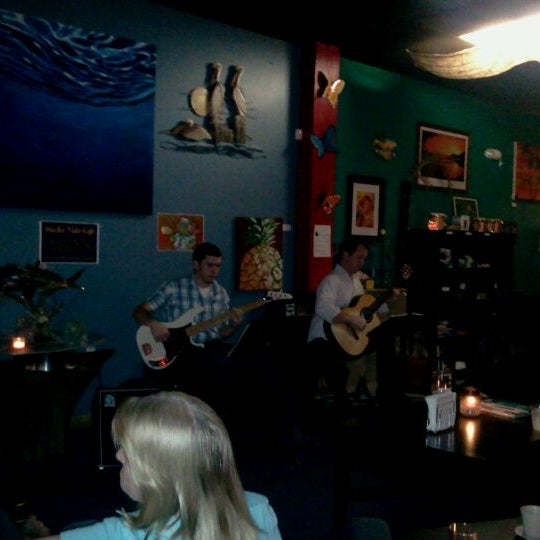 Photo taken at Mocha Vida Cafe by Derrick R K. on 3/25/2012