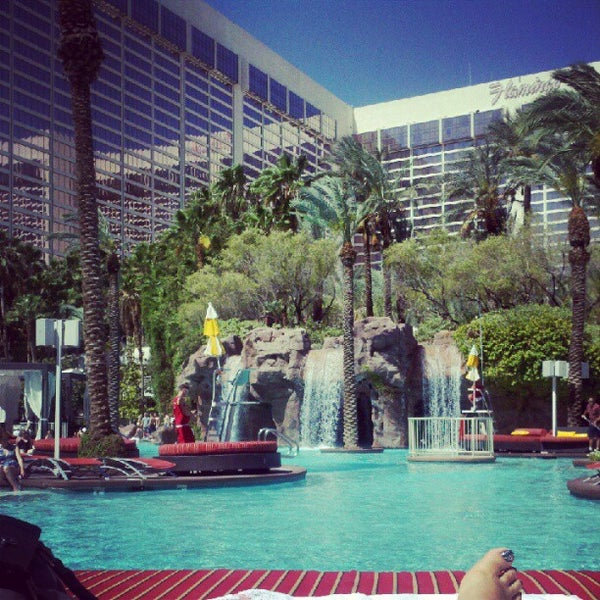 Photo taken at Flamingo GO Pool by Dominique H. on 5/18/2012