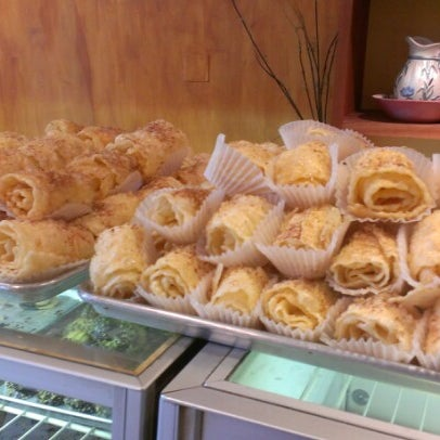 Photo taken at Pan Hellenic Pastry Shop by Candice K. on 7/13/2012