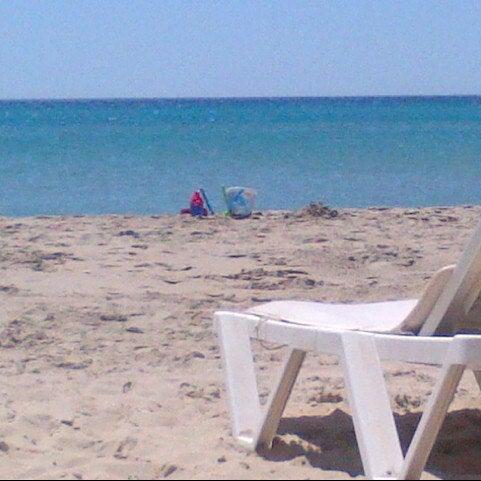 Photo taken at Ramo Beach by Murat T. on 8/29/2012