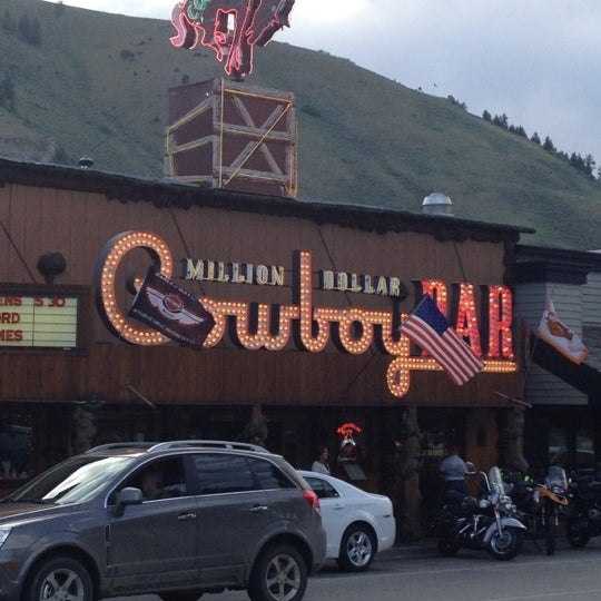 Photo taken at Million Dollar Cowboy Bar by Eric T. on 6/19/2012