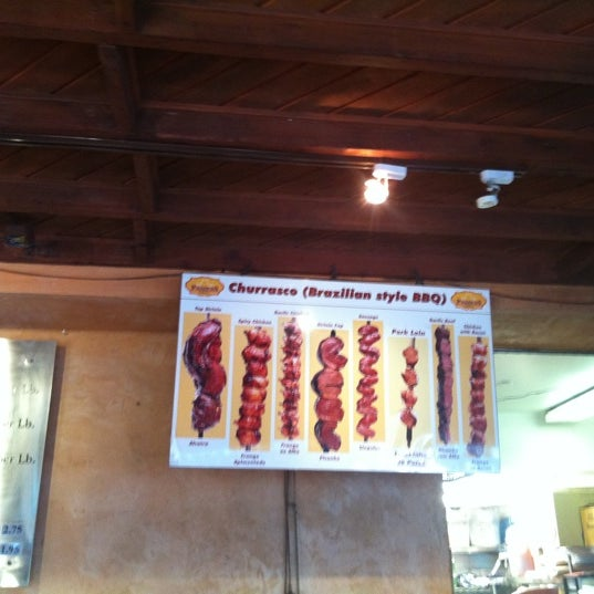 Photo taken at Pampas Grill Farmers Market by Claudia C. on 5/6/2012