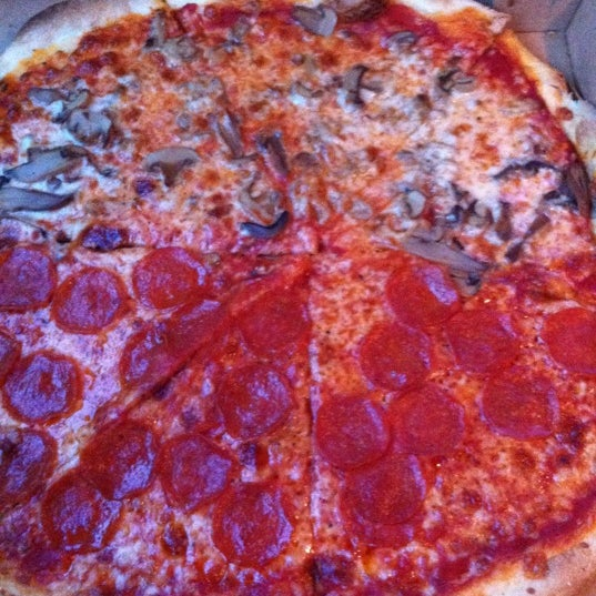 Photo taken at Toby's Original Little Italy Pizza by Katie H. on 9/5/2012