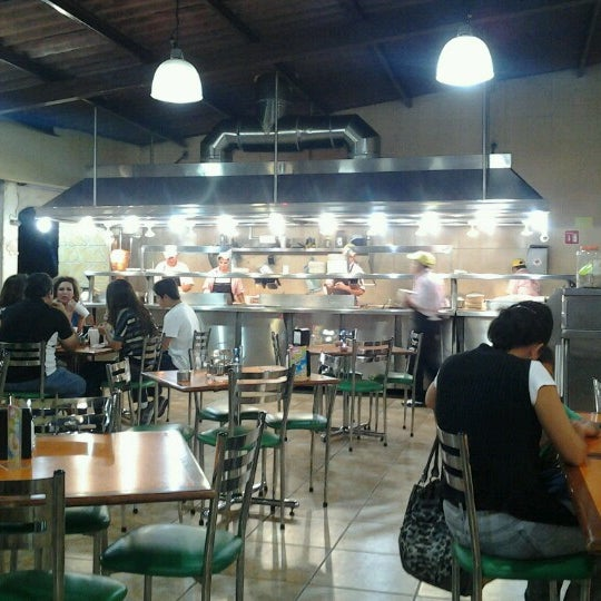 Photo taken at Los Sarapes by Eduardo on 7/18/2012