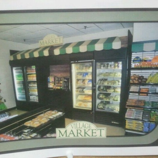 Photo taken at Village Market (Lobby Level) by Arnaldo R. on 4/5/2012