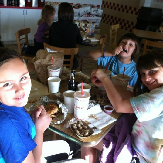 Photo taken at Five Guys by Mollie M. on 3/26/2012