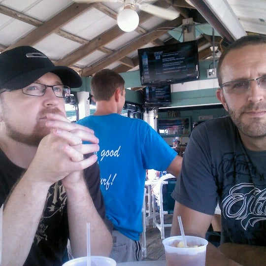 Photo taken at The Surf Restaurant & Bar by Deanna N. on 7/26/2012